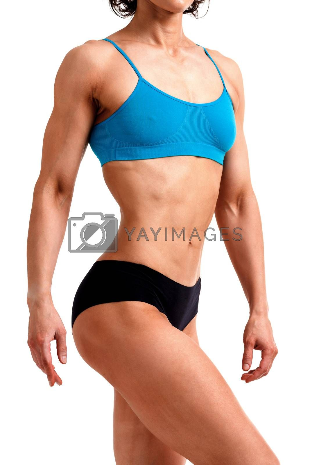 Fitness woman posing against a white background, isolated