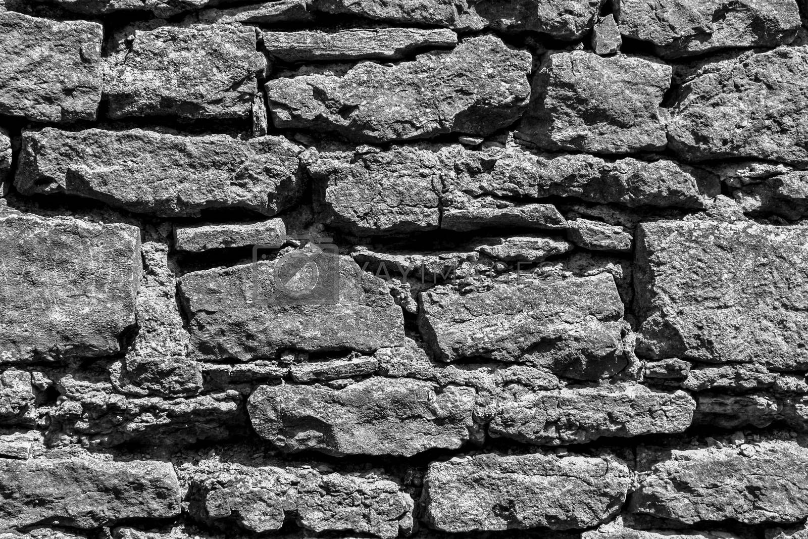 Old stonewall fragment of medieval castle. Close up view