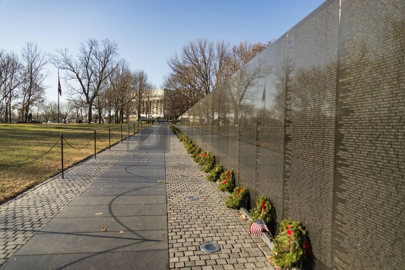 WASHINGTON DC -December 17, 2017: Names on Vietnam War Veterans Memorial on December 17, 2017 in Washington DC, USA. The memorial receives around 3 million visitors each year.