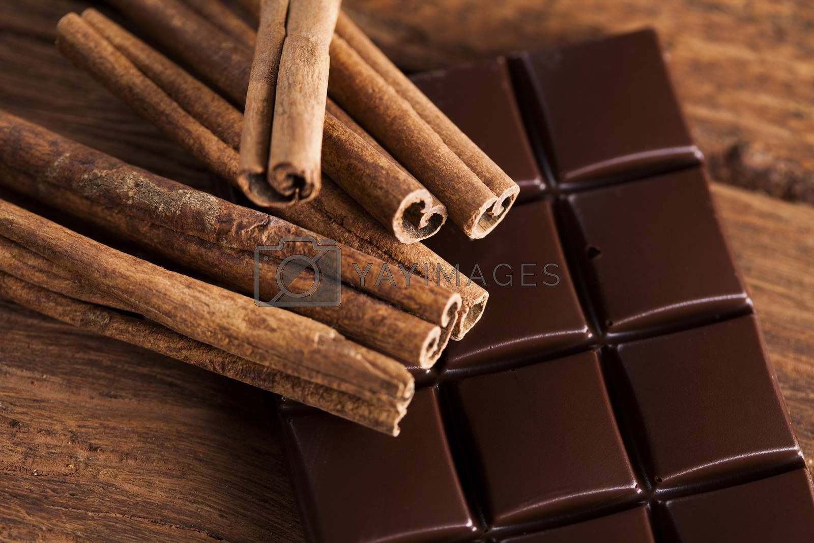 Royalty free image of Cinnamon, Dark chocolate with candy sweet by JanPietruszka