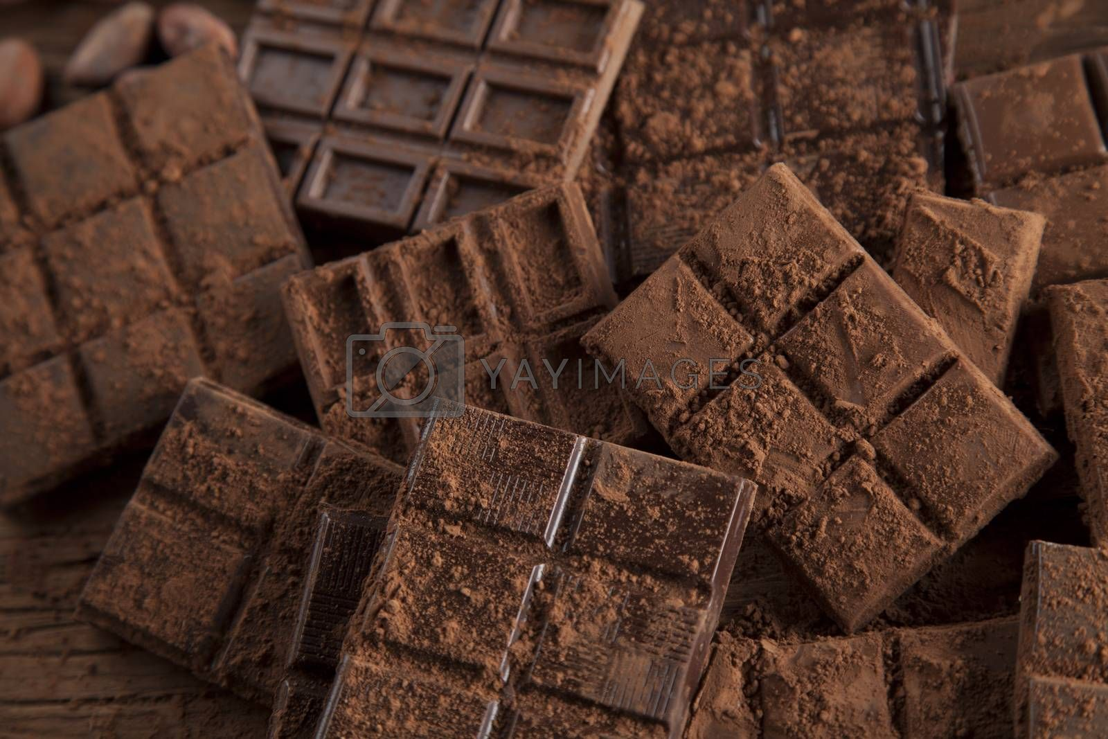 Royalty free image of Bars Chocolate , candy sweet, dessert food on wooden background by JanPietruszka