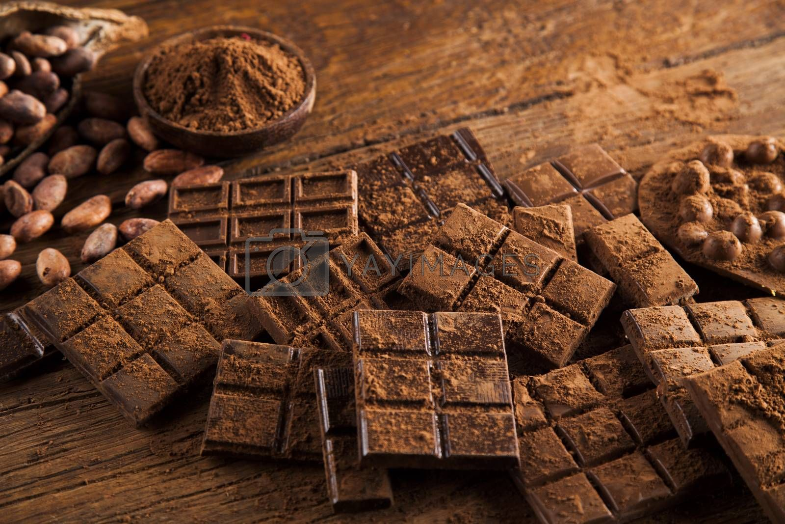 Royalty free image of Chocolate bar, candy sweet, dessert food on wooden background by JanPietruszka