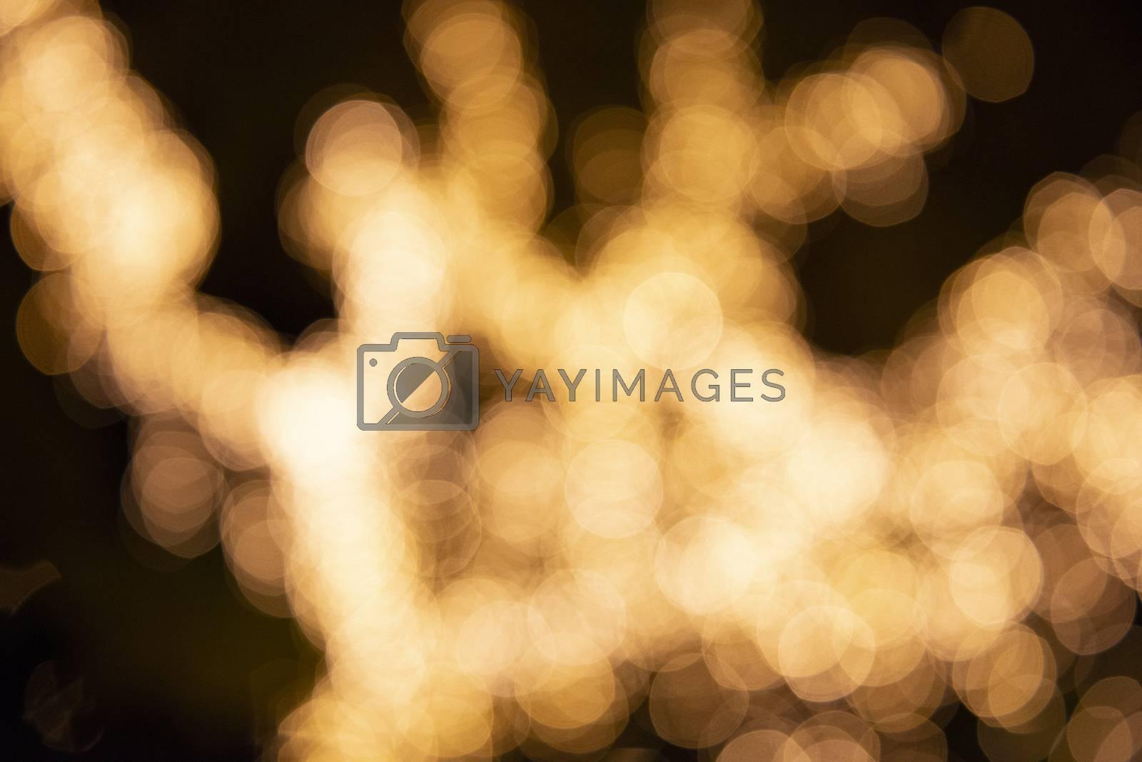 Close up of large golden bokeh shapes.