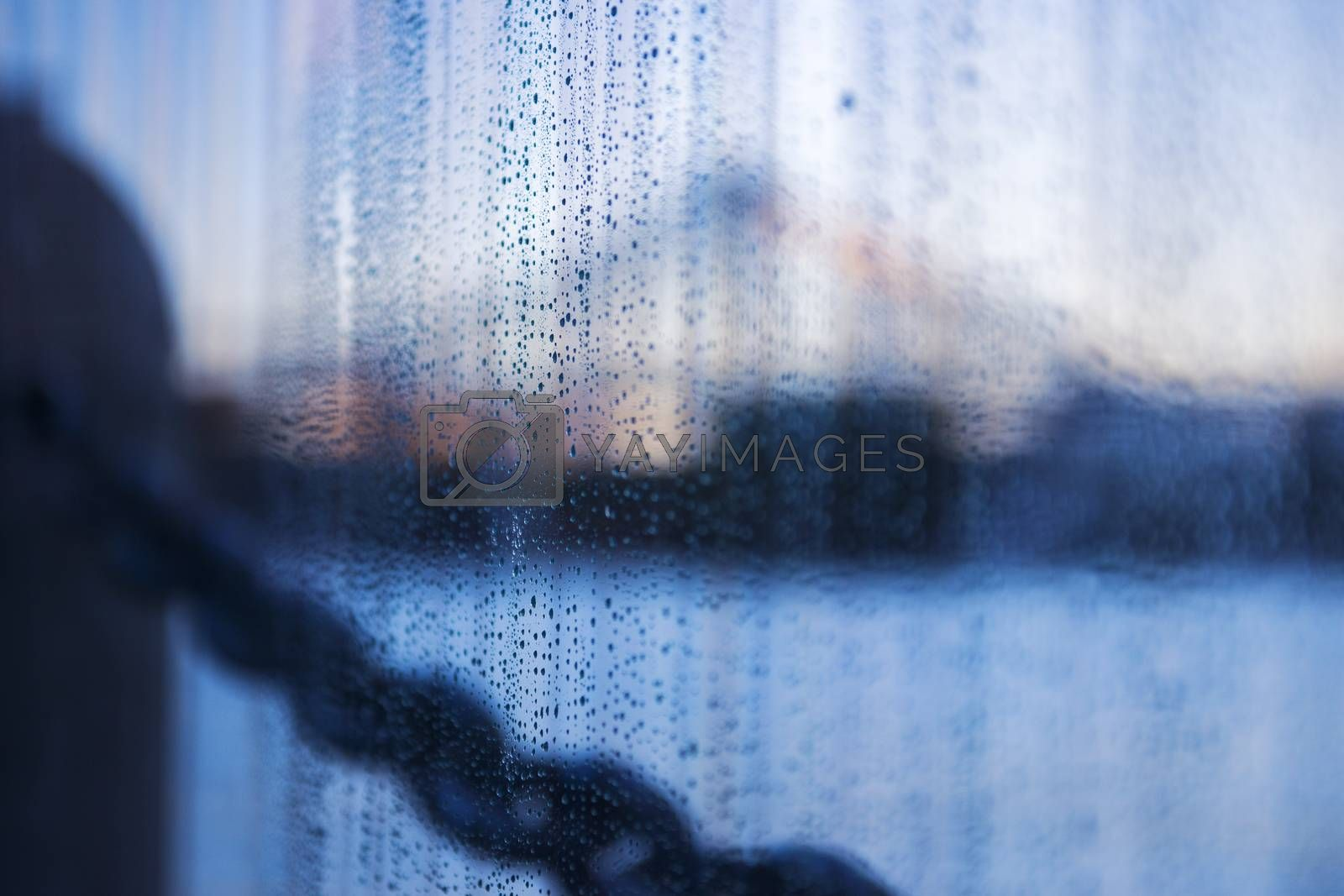Close up of lots of rain drops on glass.