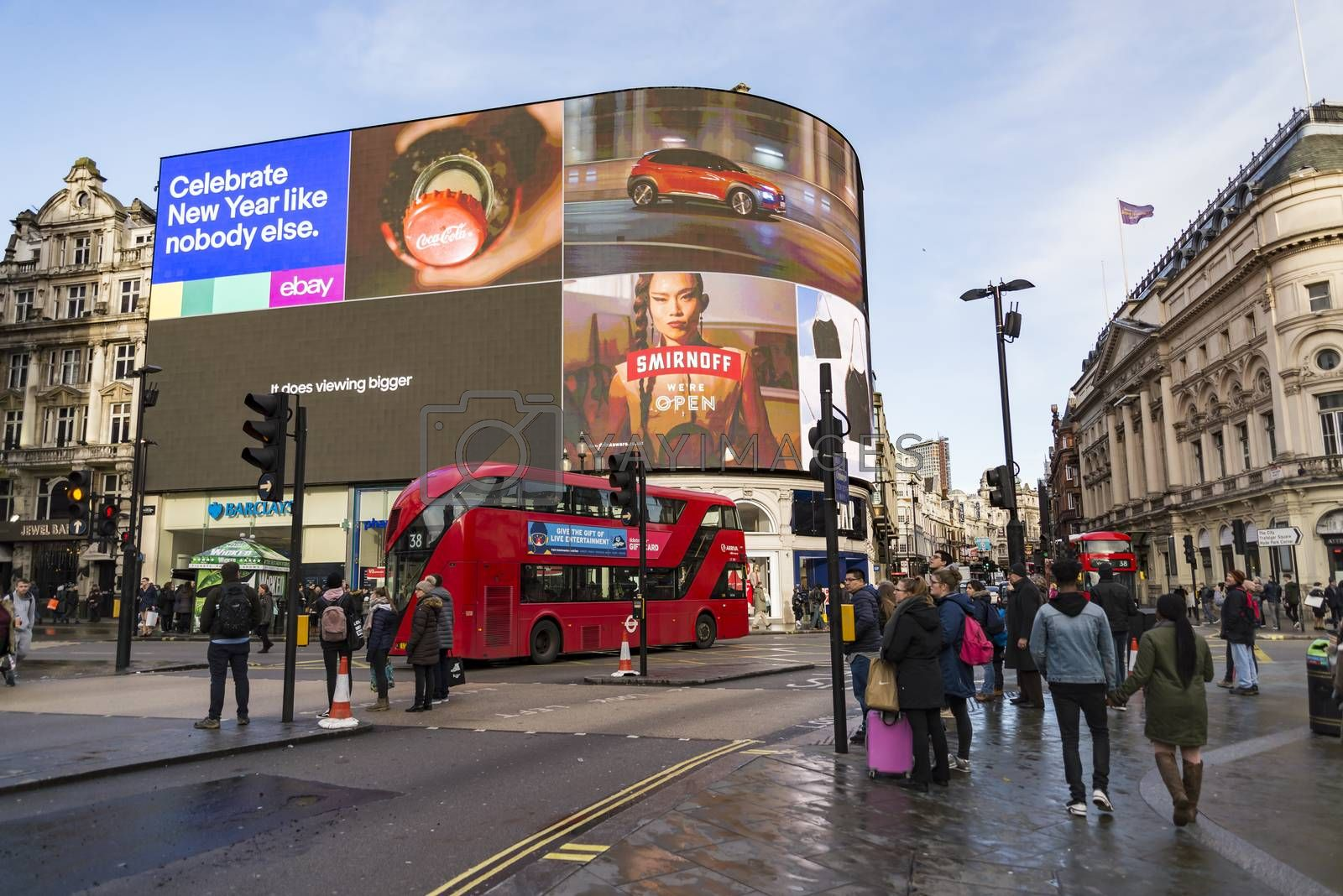 LONDON - DECEMBER 29: view of Piccadilly Circus with cabs , buses and crowds on December 29, 2017 in London UK. Famous advertisements have been here for at least 20 years and are considered symbols of famous square.