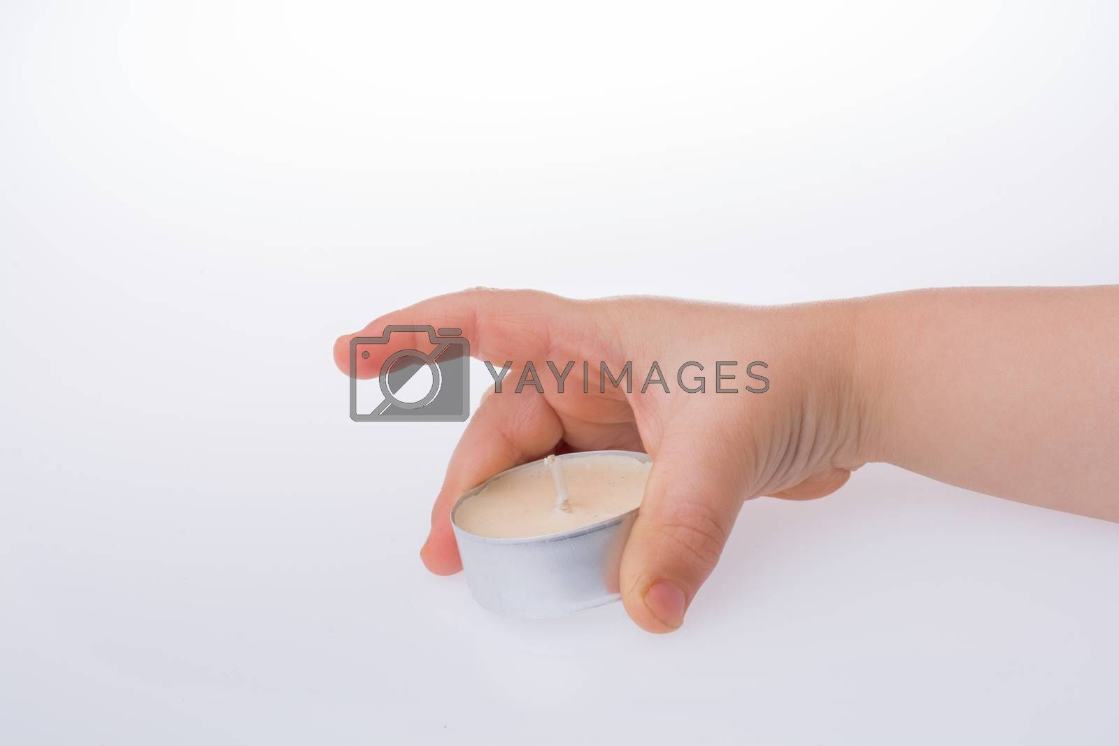 White color small Candle in hand on a white background