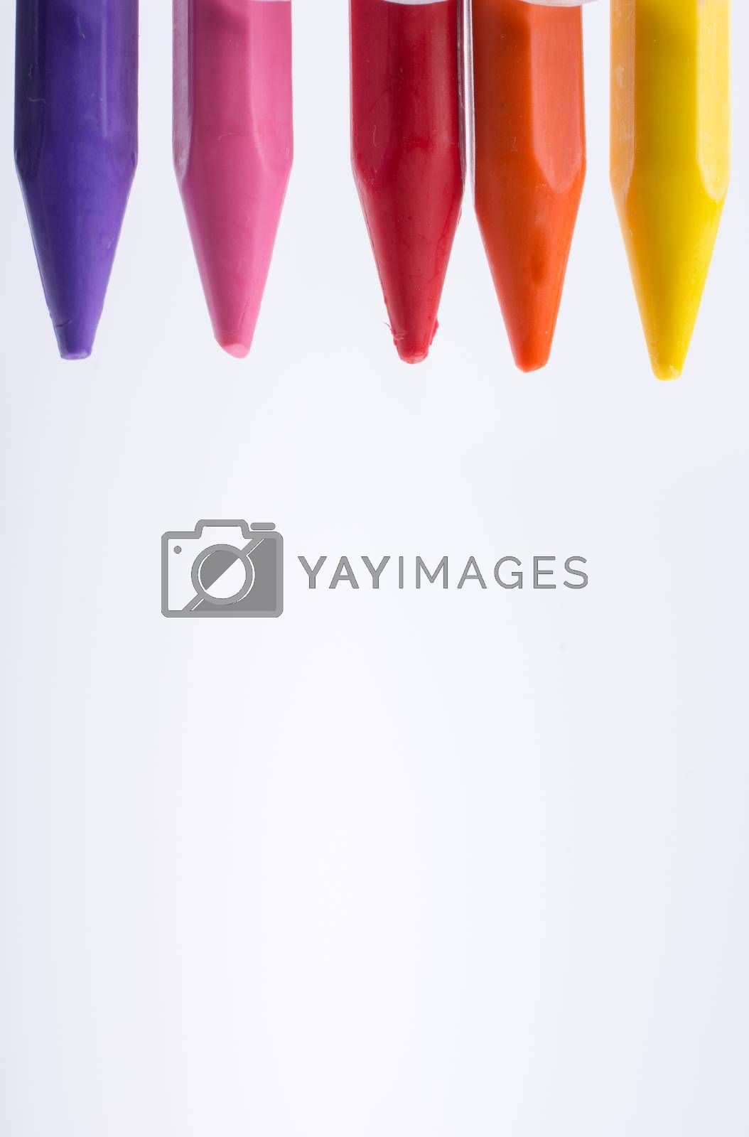 Crayons of various color on white background