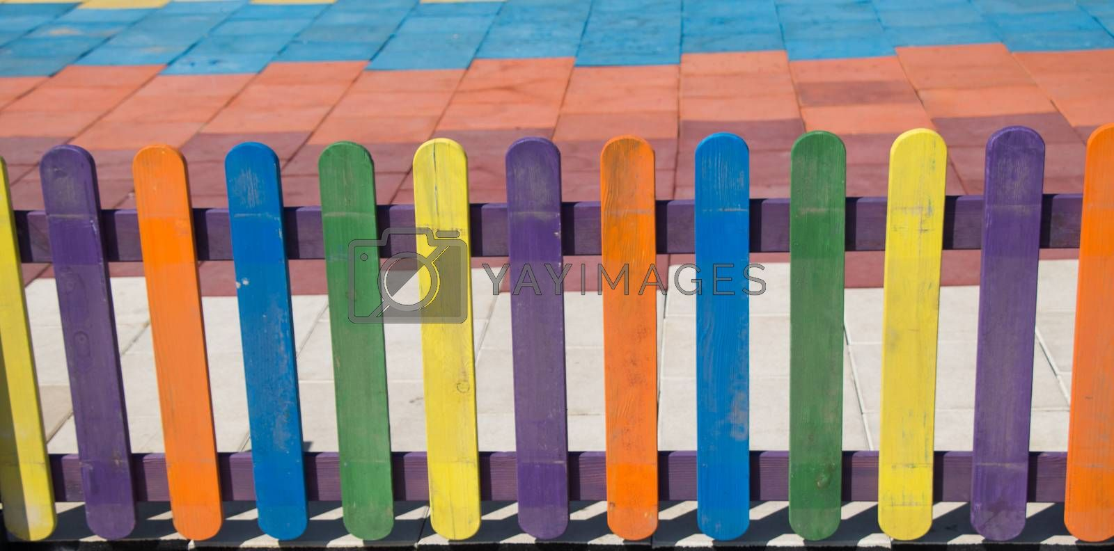 Close up of a part of decorative colorful wooden fence