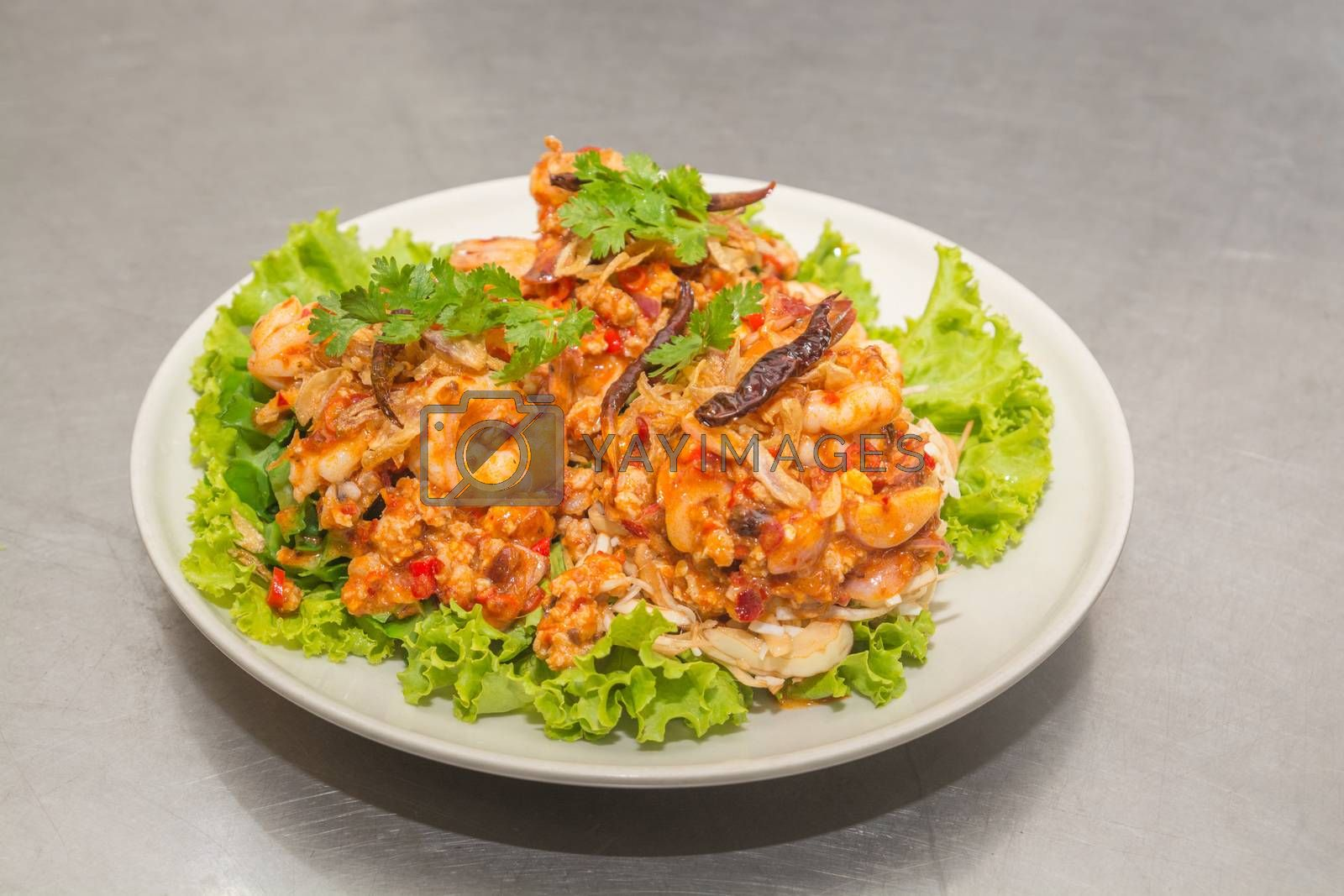 Spicy Seafood Salad, Mix of Squid, Shrimp and Shellfish with Spring Onion, Lettuce, Red Chili and Parsley, Thai food or Cuisine