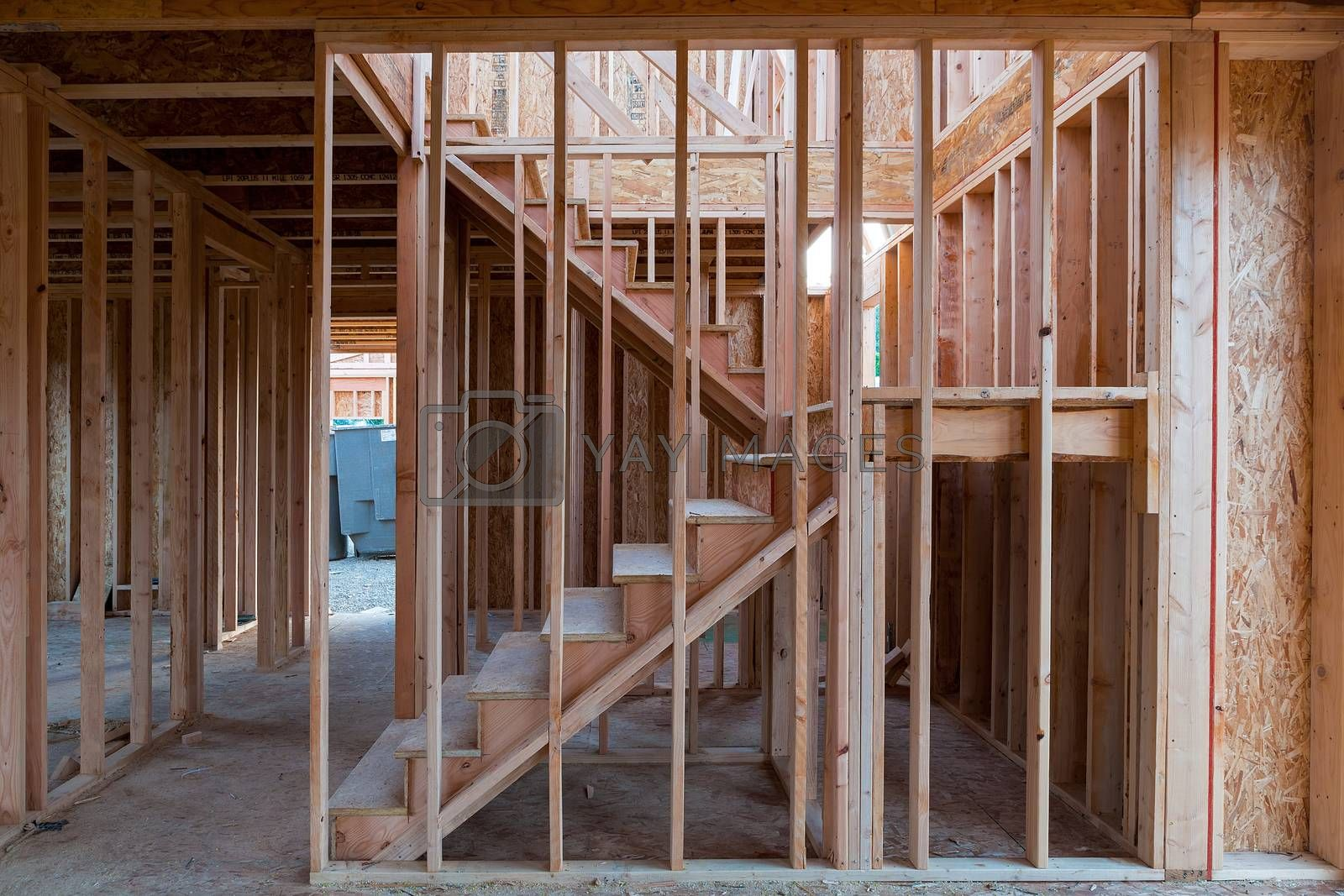 New home construction interior wood stud framing ceiling beams entryway staircase