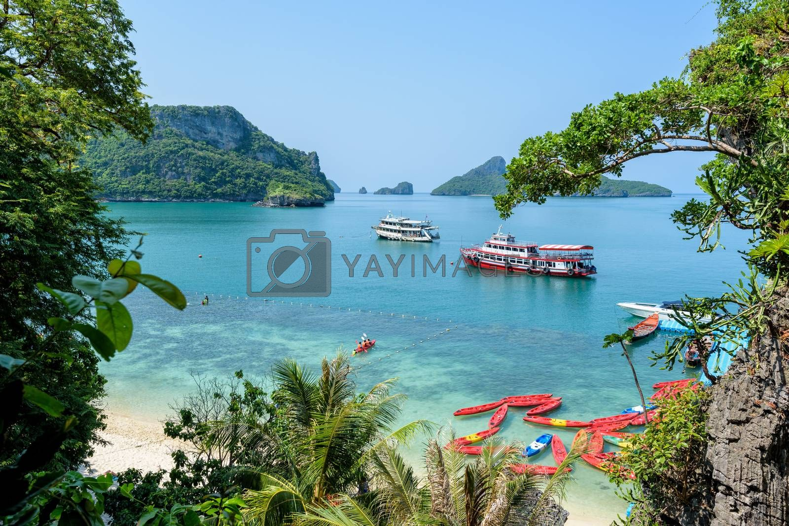 High angle view beautiful nature landscape of travel boat anchored on the sea in summer near the beach pier at Koh Mae Ko island in Mu Ko Ang Thong National Park, Surat Thani, Thailand