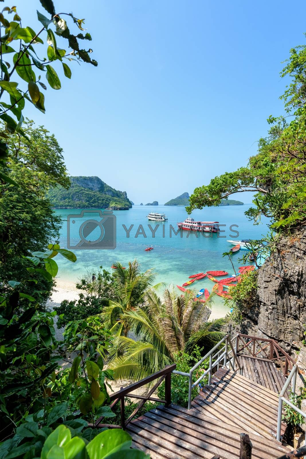 High view beautiful nature landscape of stairs up to the Thale Nai and travel boat on the sea in summer near the beach at Koh Mae Ko island in Mu Ko Ang Thong National Park, Surat Thani, Thailand