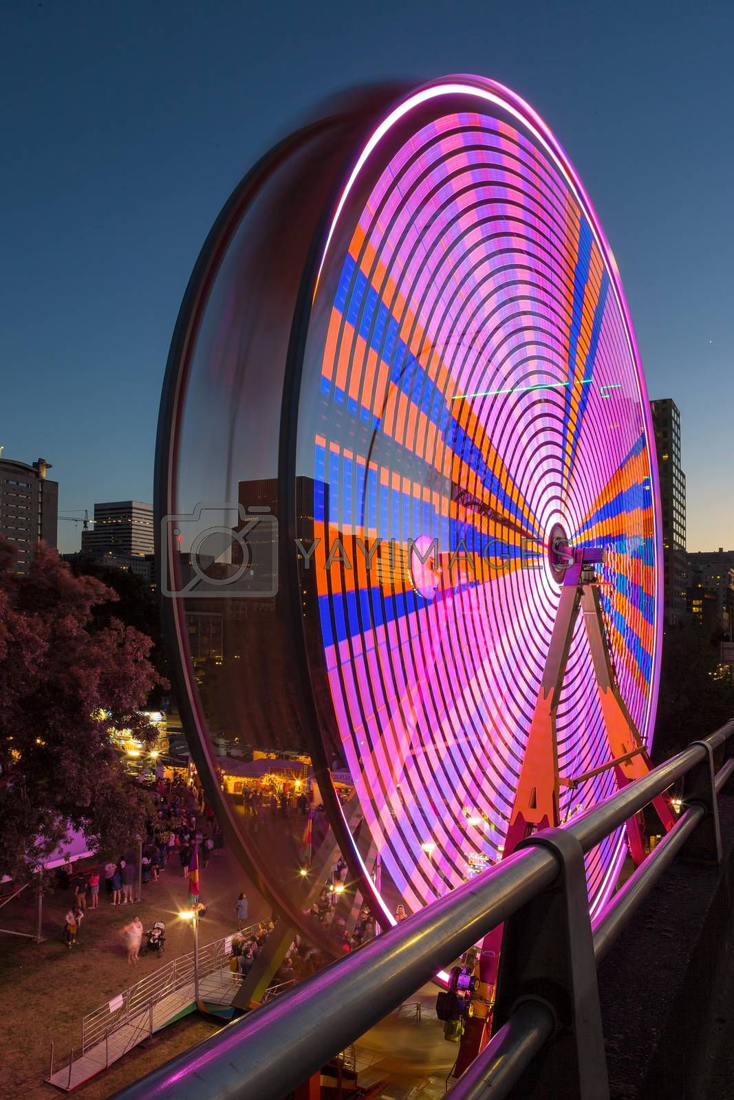 Ferris Wheel at night during Portland Rose Festival in downtown waterfront colorful lights long exposure