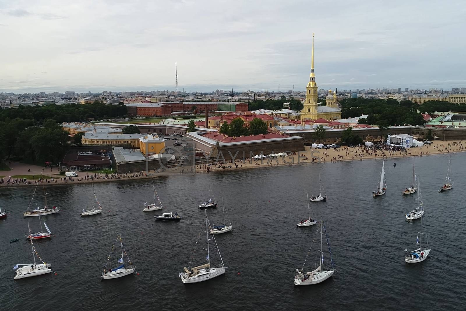 Festival of yachts in St. Petersburg on the river neve. Sailing yachts in the river by Nirkov