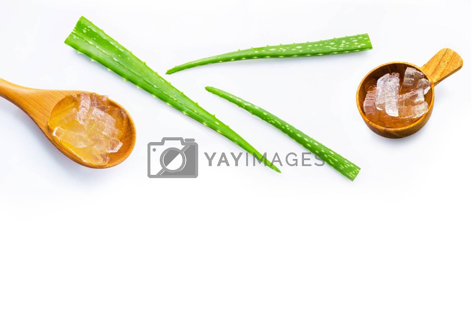 Aloe vera fresh leaves with aloe vera gel on wooden spoon.  by Bowonpat