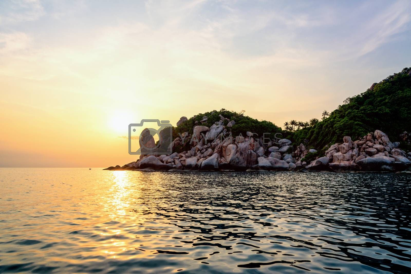 Beautiful nature landscape group strange stone of Buddha Point at cape near John-Suwan viewpoint under the colorful sky and sun during sunset on the sea in Ko Tao island, Surat Thani, Thailand