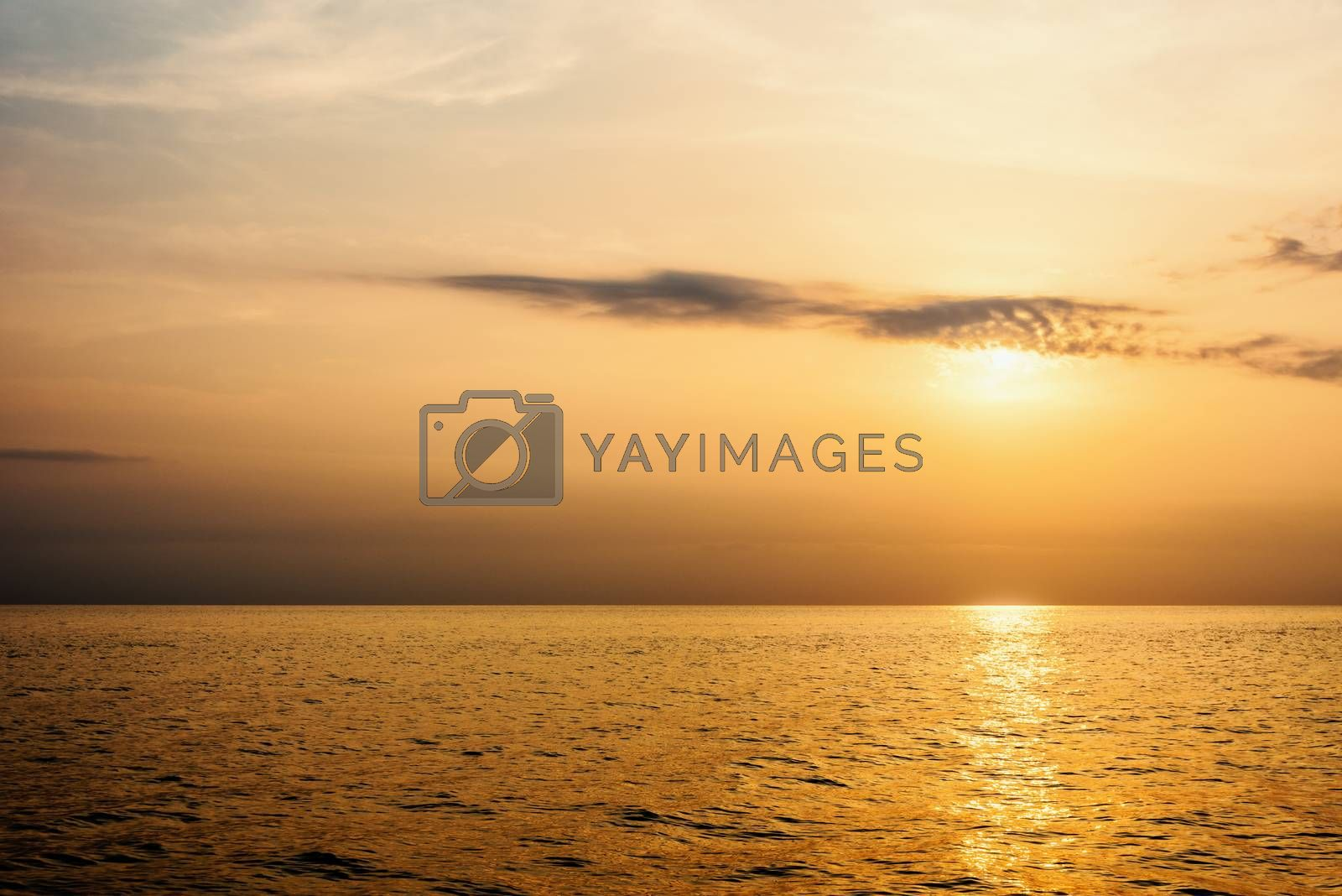 Beautiful nature landscape of colorful sky and warm orange light of the sun at sunset over the sea during summer for background in Thailand
