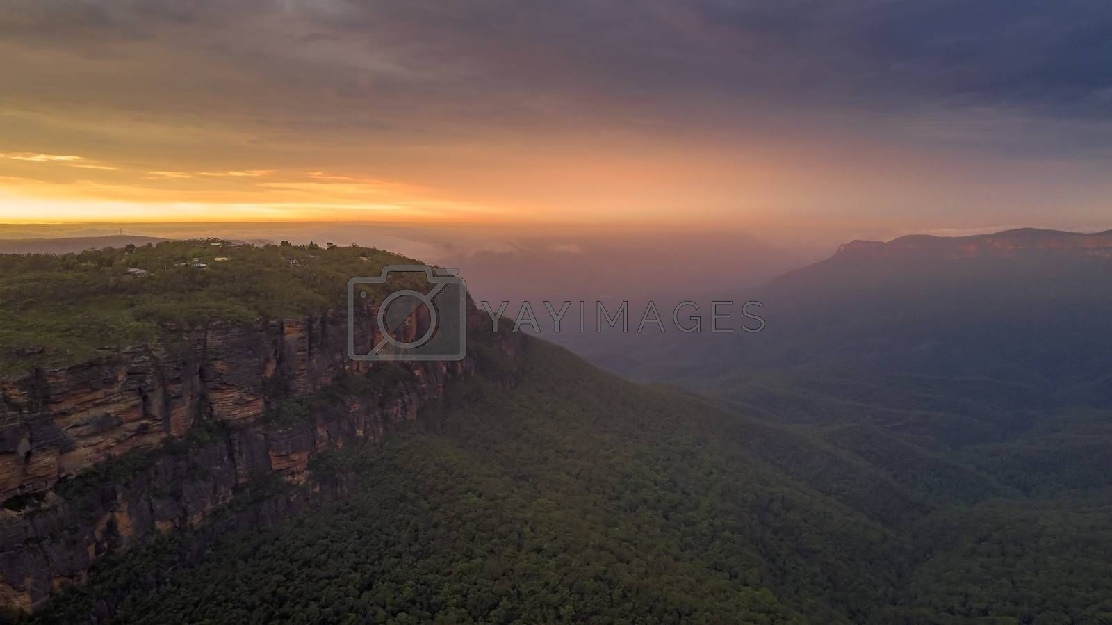 magical sunrise with cloud cover and mist filled Jamison Valley, Blue Mountains, Australia