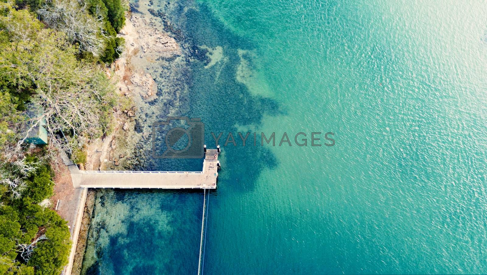 A lovely jetty popular with fisherman juts out from the rocky shore into the pristine waters of Sydney coast