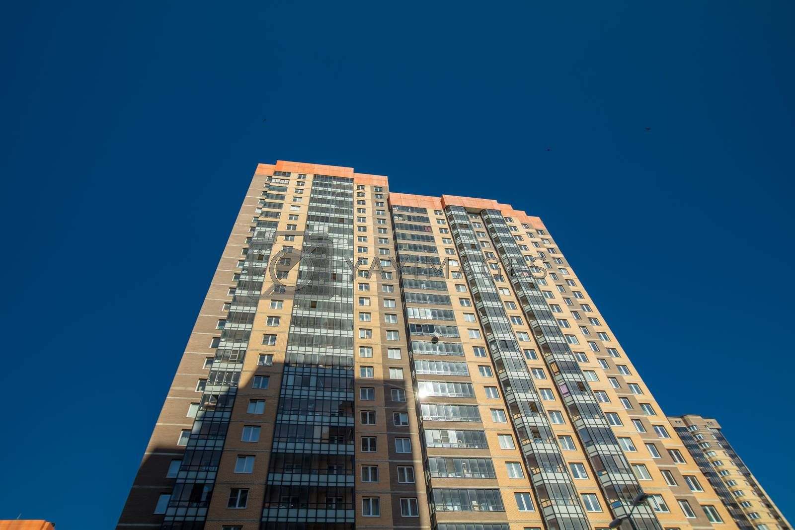 Modern building exterior low angle view with blue sky