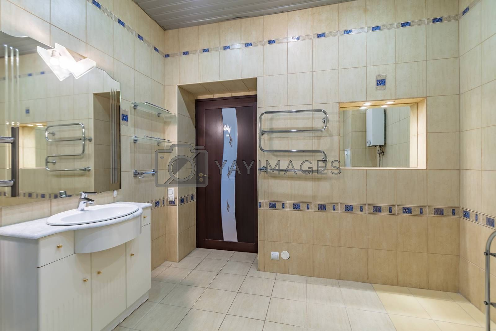 modern mirror and ceramic sink in bathroom