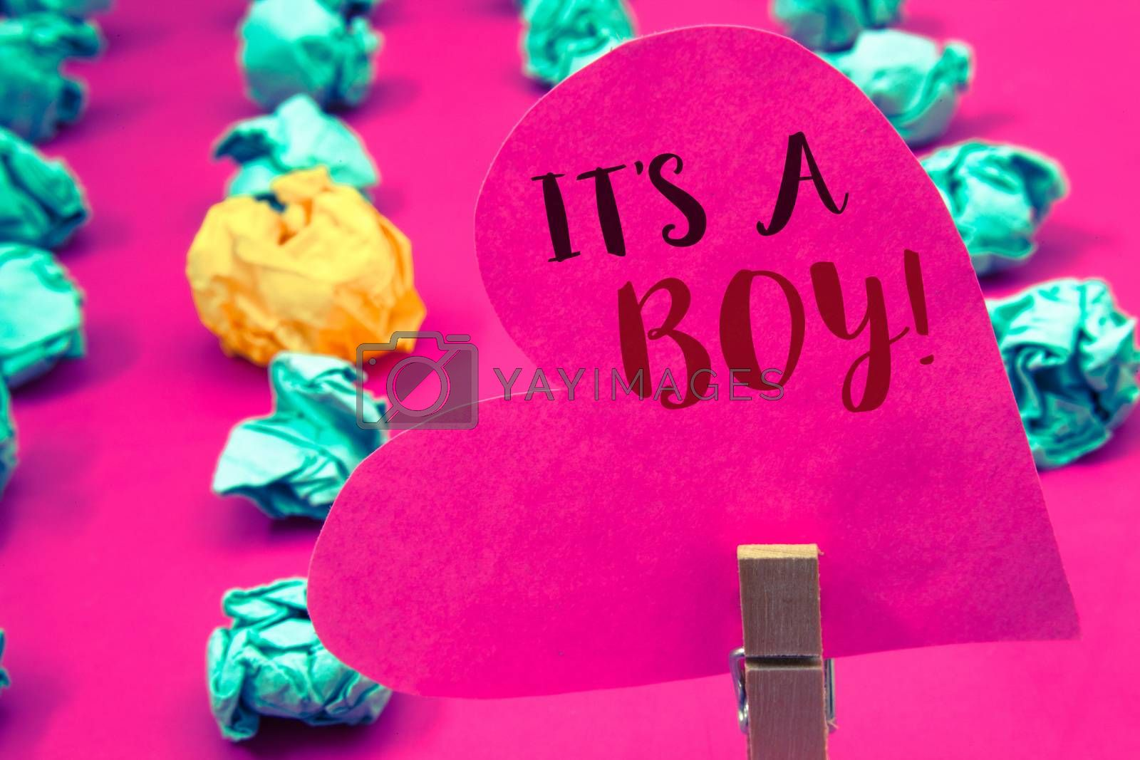 Words writing texts It S A Boy Motivational Call. Business concept for Male baby is coming Gender reveal CelebrationClothespin hold holding pink heart with ideas words several crumpled papers