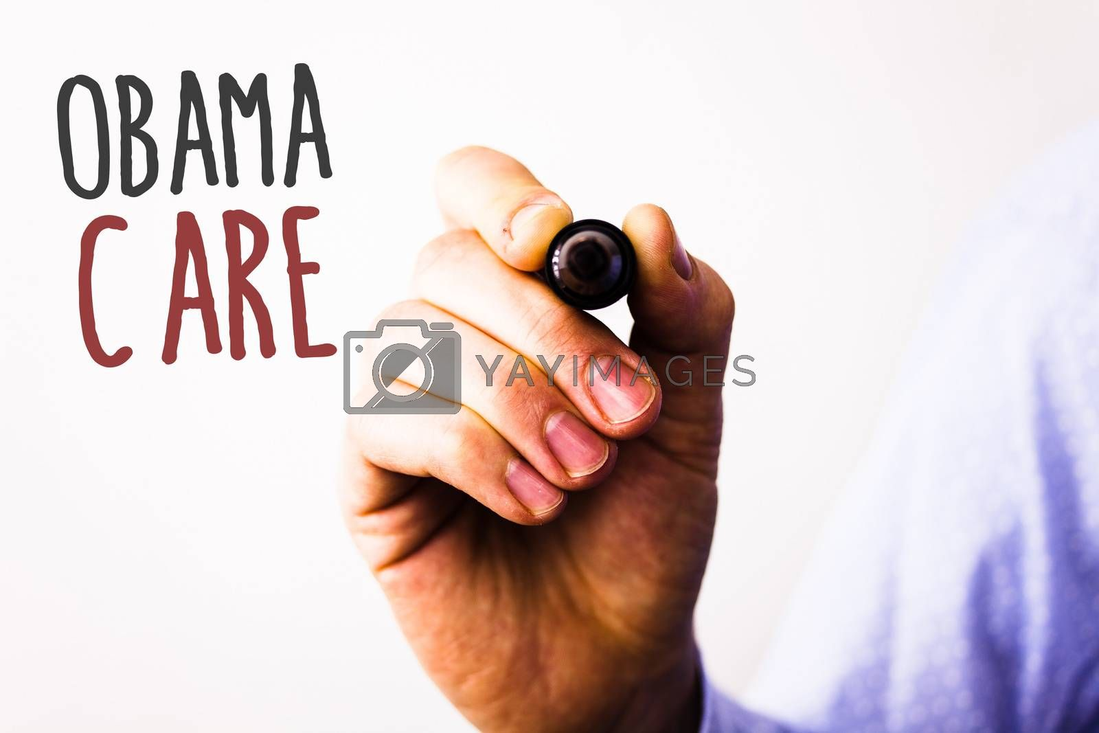 Conceptual hand writing showing Obama Care. Business photo texts Government Program of Insurance System Patient ProtectionMan holding pen pointing idea message black red letters white background