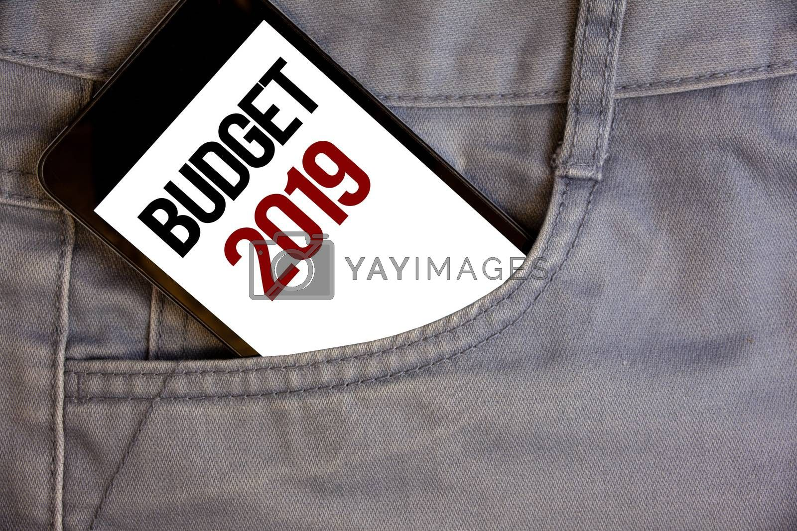 Writing note showing  Budget 2019. Business photo showcasing New year estimate of incomes and expenses Financial PlanConcept on cell phone on jean pocket white screen black and red letters