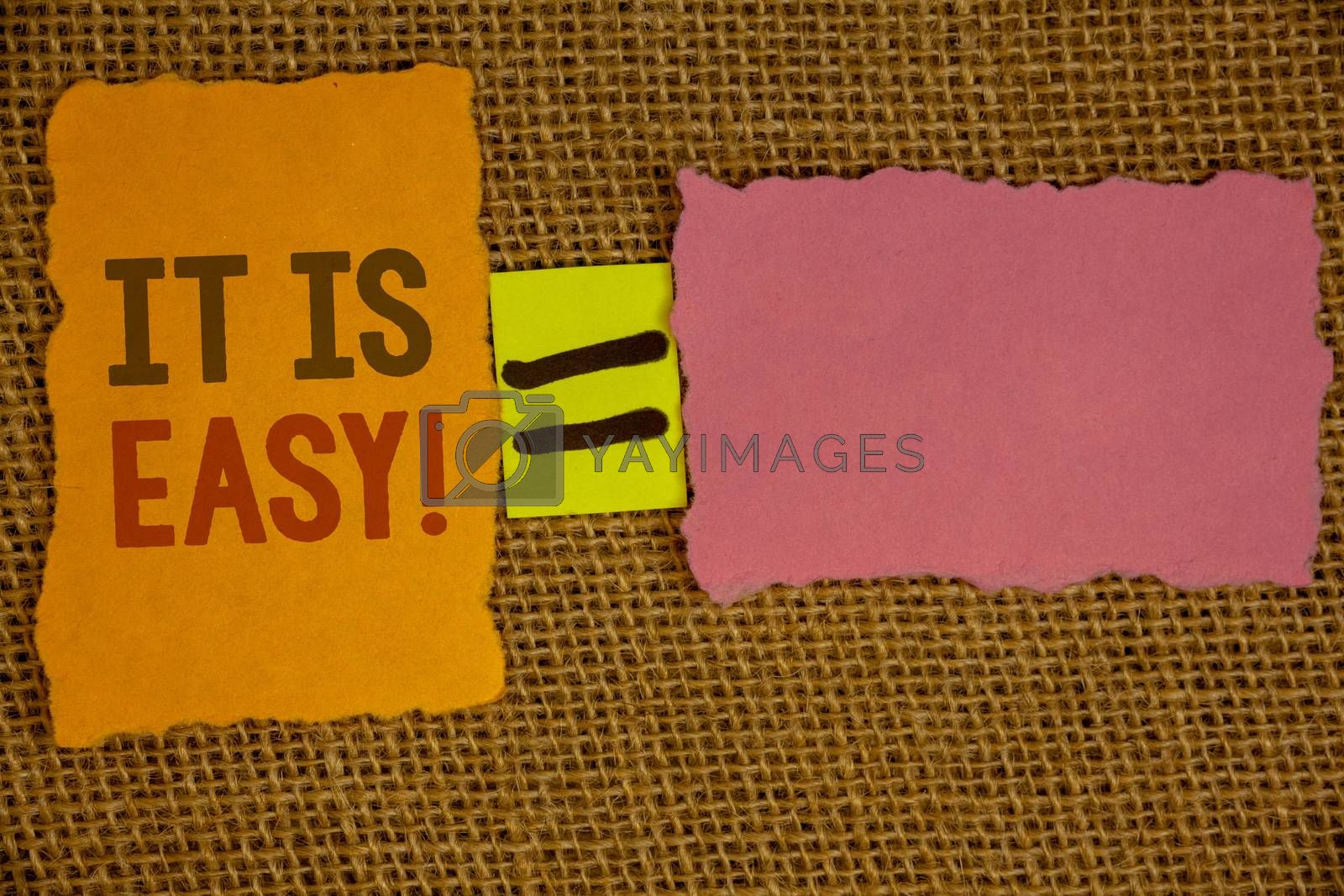 Words writing texts It Is Easy Motivational Call. Business concept for Clear Simple Not complicated Basic EffortlessIdeas created on orange yellow pink papers equal sign wicker background