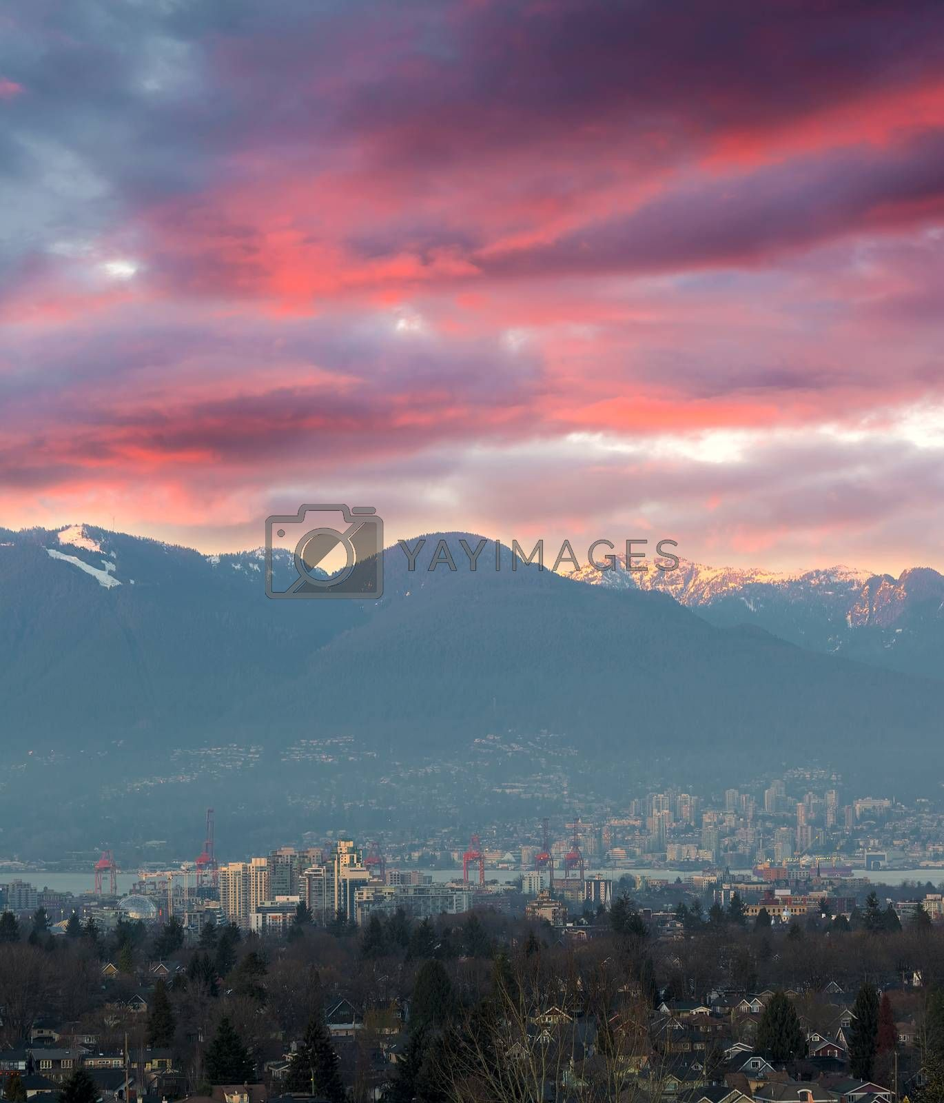 Sunset sky over city port of Vancouver BC British Columbia Canda