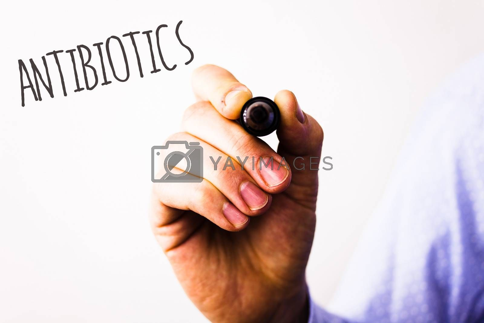 Conceptual hand writing showing Antibiotics. Business photo texts Drug used in treatment and prevention of bacterial infectionsMan holding pen pointing idea message black red letters white background