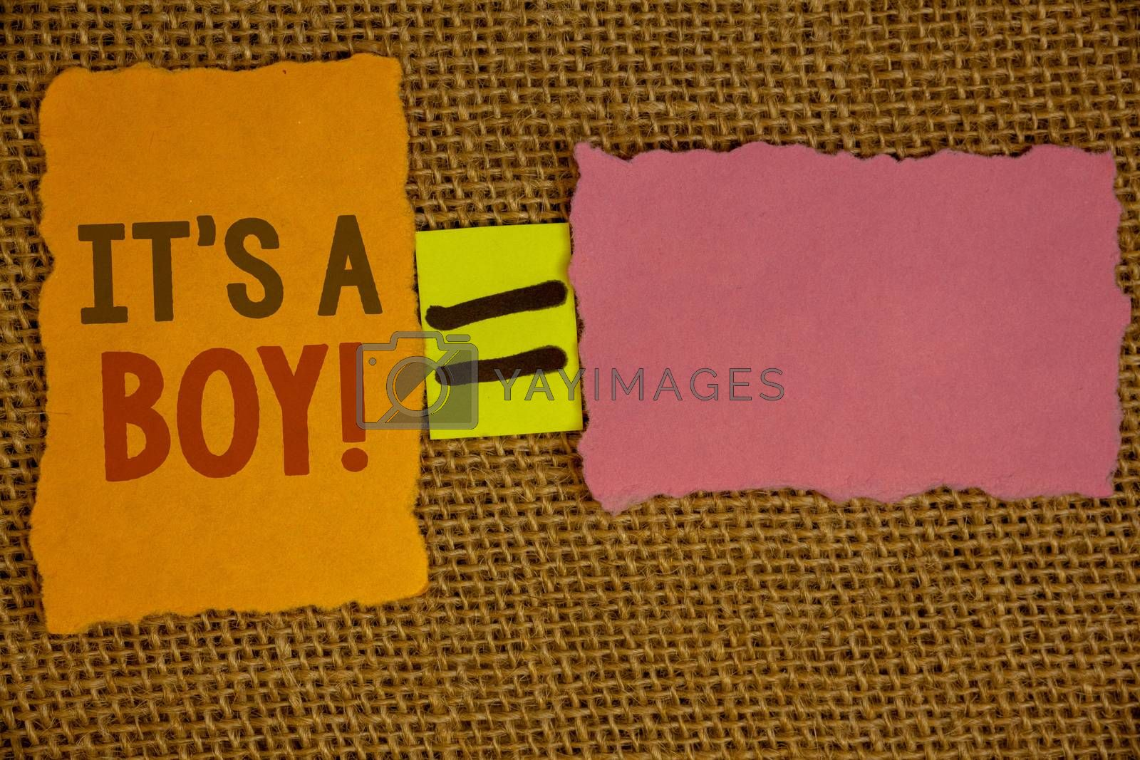 Words writing texts It S A Boy Motivational Call. Business concept for Male baby is coming Gender reveal CelebrationIdeas created on orange yellow pink papers equal sign wicker background