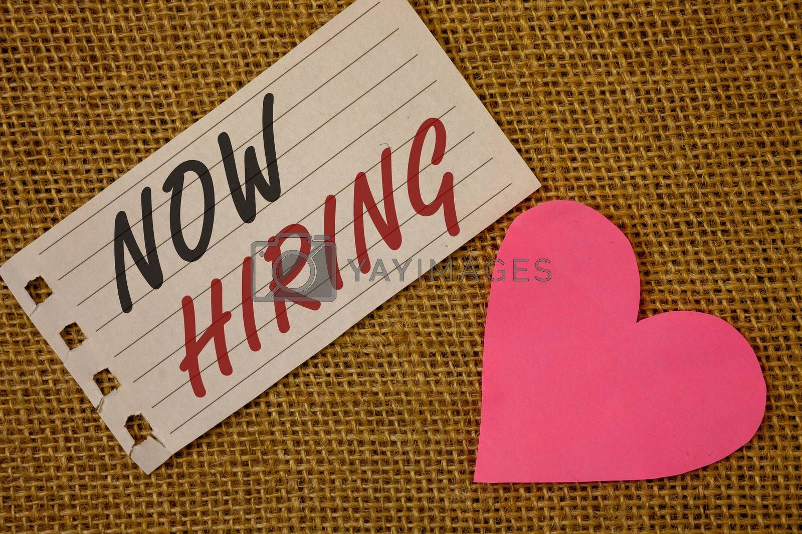 Text sign showing Now Hiring. Conceptual photo Workforce Wanted Employees Recruitment Today Job OpportunityNotebook page Wicker background Pink Heart Black Red letters Love note