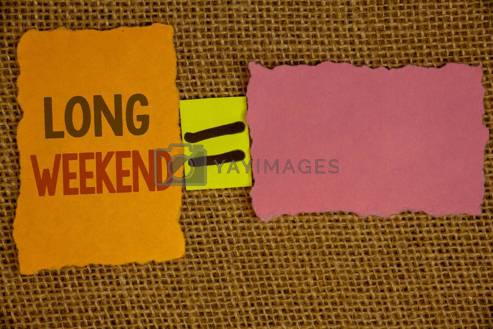 Words writing texts Long Weekend. Business concept for Short vacation Holiday season Relaxing Recreation timeIdeas created on orange yellow pink papers equal sign wicker background