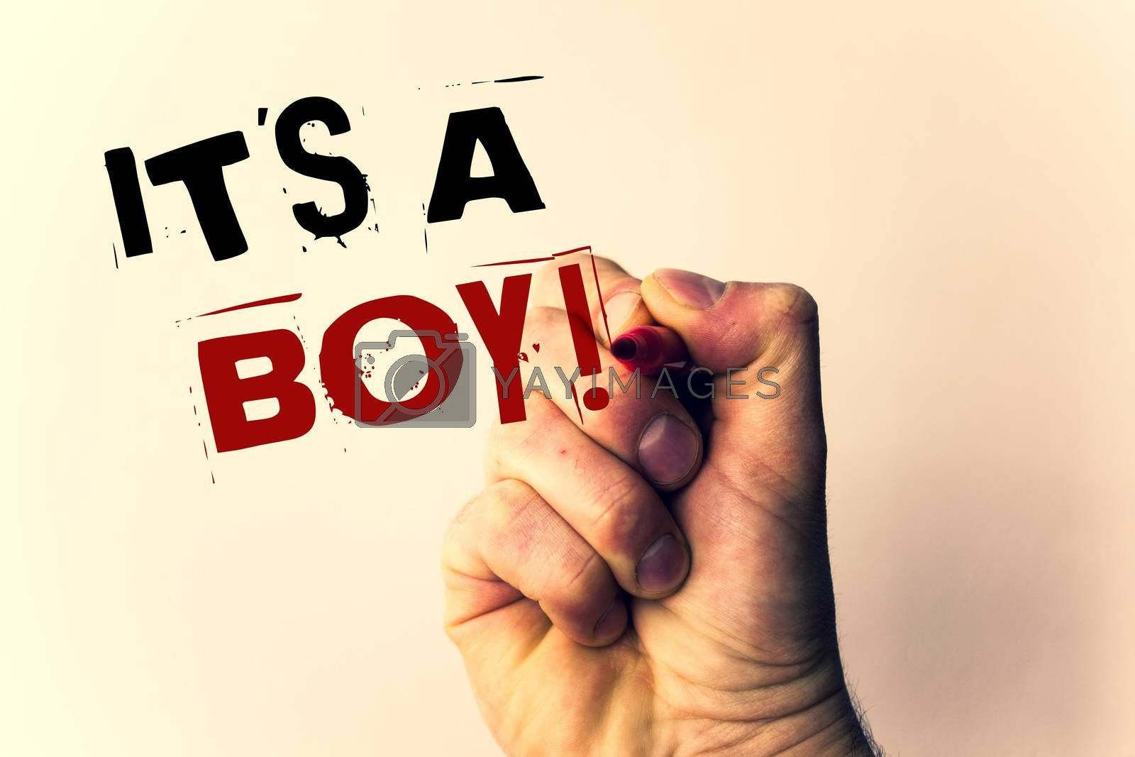 Handwriting texts writing It S A Boy Motivational Call. Concept meaning Male baby is coming Gender reveal CelebrationMan holding pen pointing idea message black red letters beige background