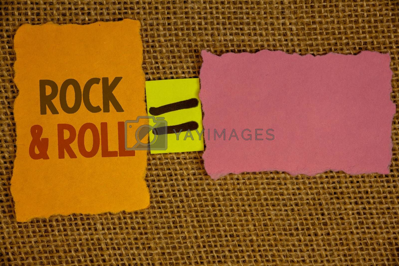 Words writing texts Rock and Roll. Business concept for Musical Genre Type of popular dance music Heavy Beat SoundIdeas created on orange yellow pink papers equal sign wicker background