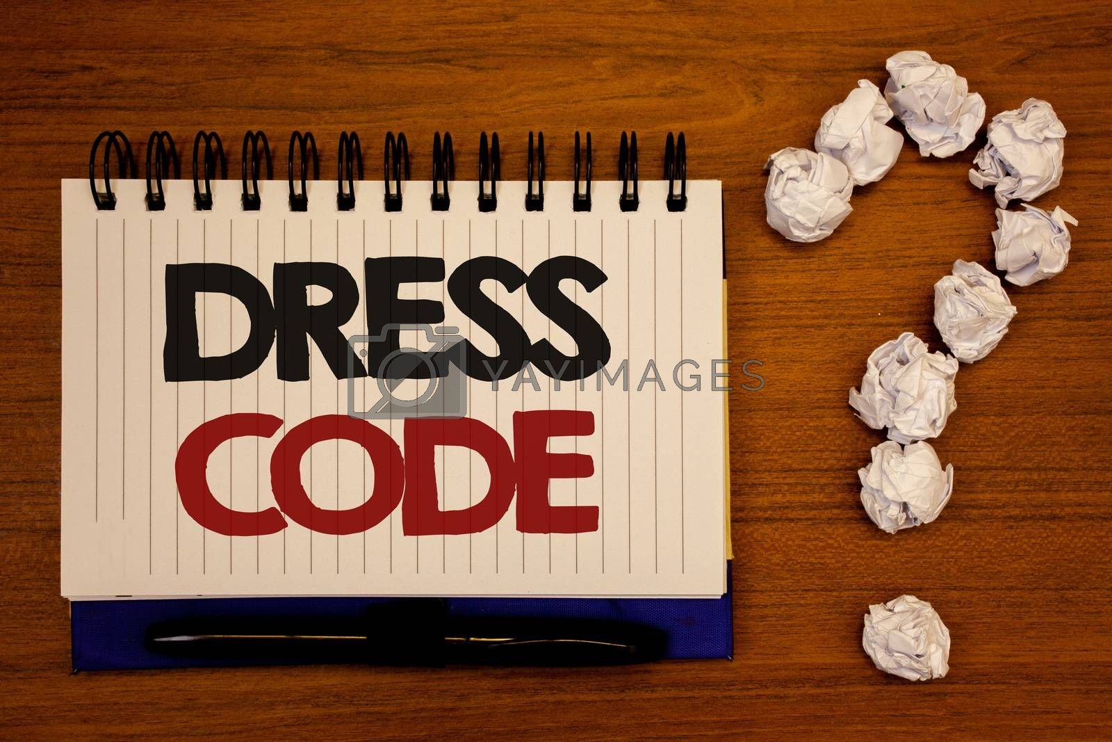 Text sign showing Dress Code. Conceptual photo Rules of what you can wear and not to school or an eventIdeas on notebook wooden background quotation mark made of crumpled papers