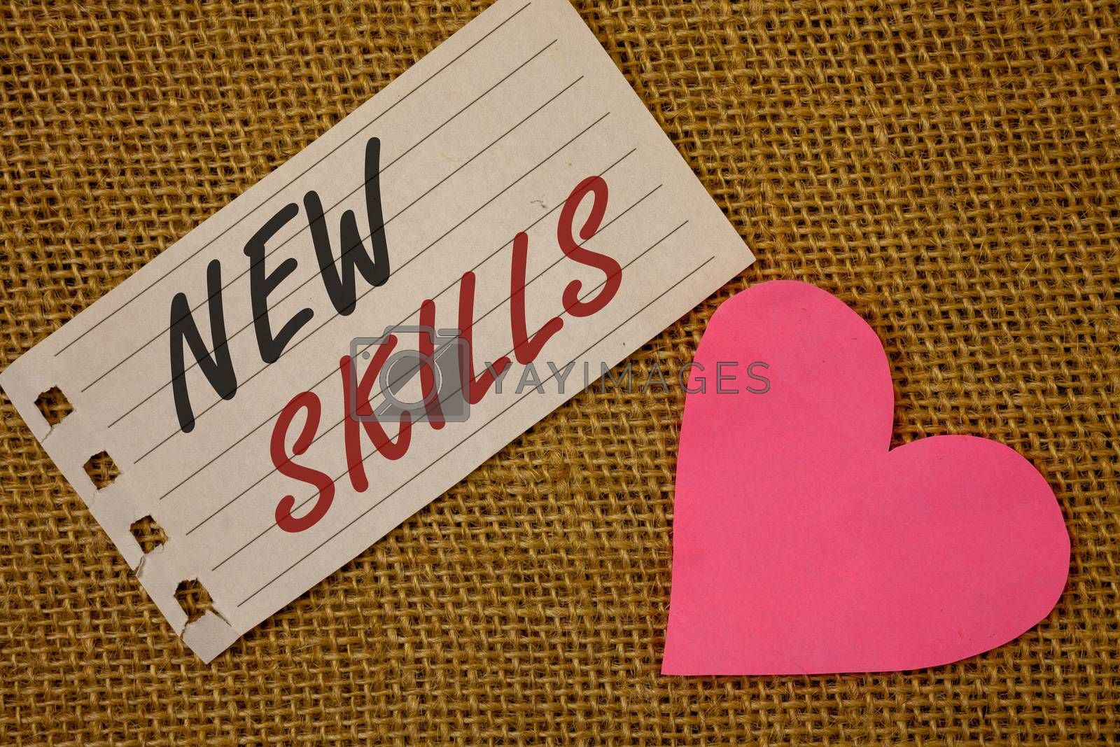 Text sign showing New Skills. Conceptual photo Recently Acquired Learned Abilities Knowledge CompetencesNotebook page Wicker background Pink Heart Black Red letters Love note