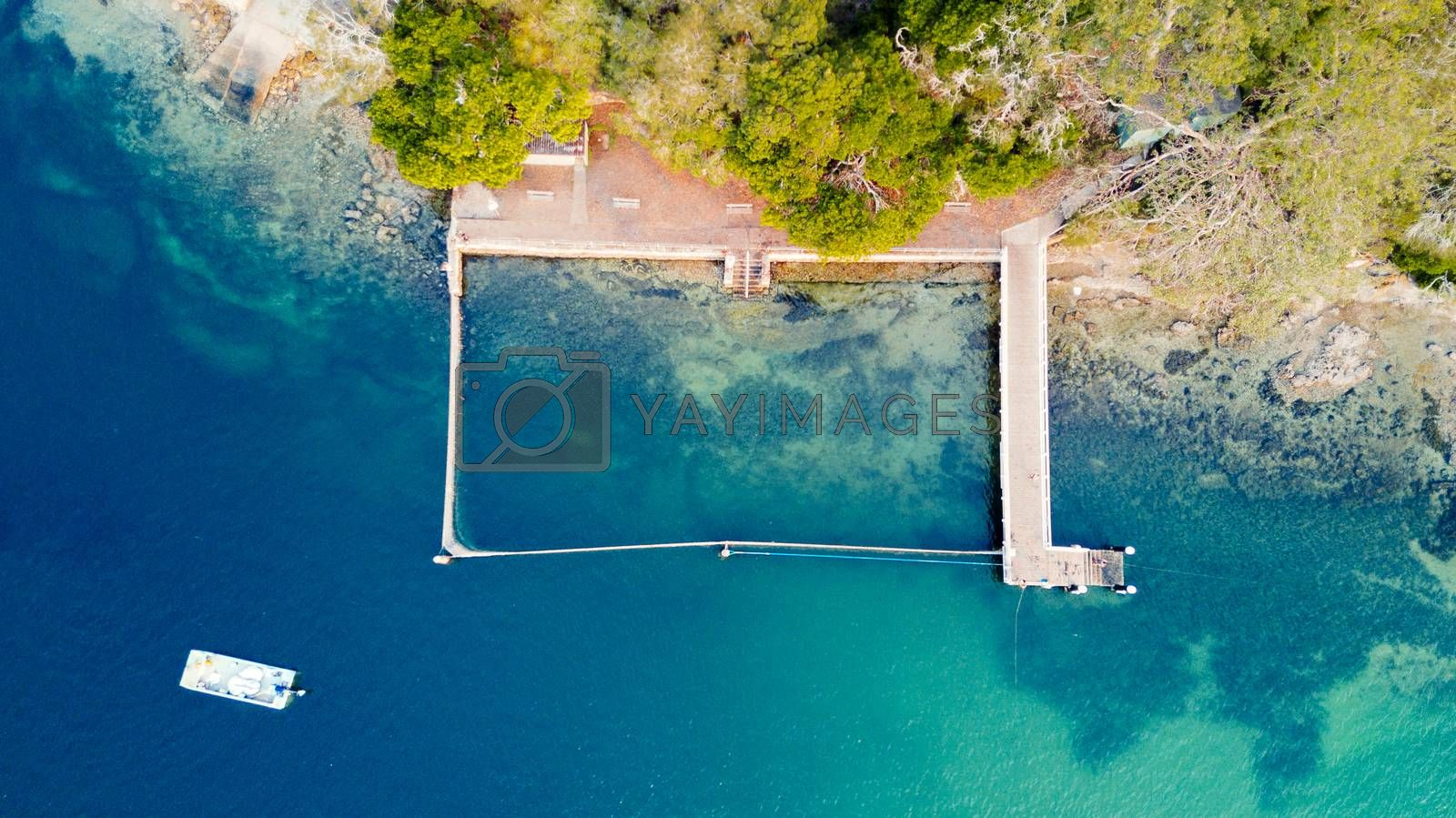 Overhead view of one of Sydney's many free coastal swimming pools.  The ocean is fenced with a free moving net.