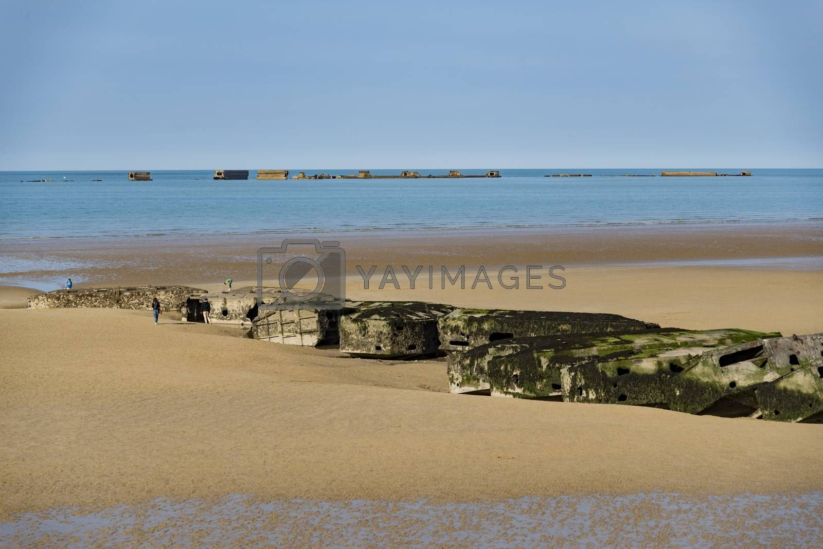 Royalty free image of The remains of the Mulberry Harbour at Arromanches by edella