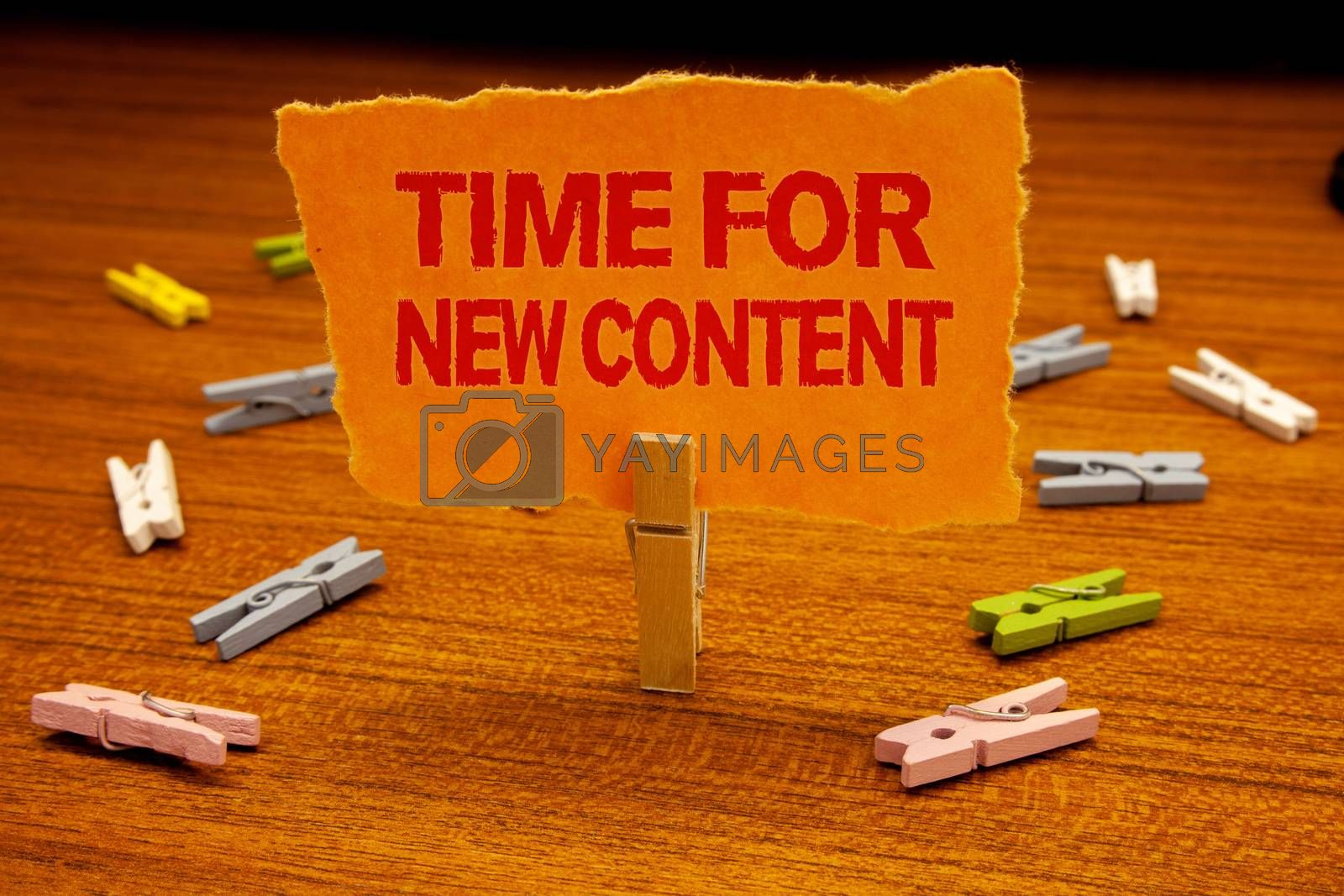 Writing note showing  Time For New Content. Business photo showcasing Copyright Publication Update Concept Publishing Paperclip holding orange page show red text woody floor with clip