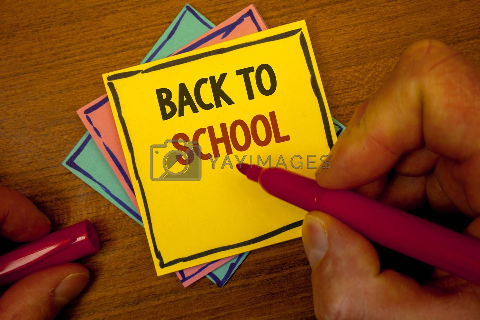 Conceptual hand writing showing Back To School. Business photo text Return to class first day of studies Classroom Arriving Text colorful paper notes hand red marker open cap desk letter