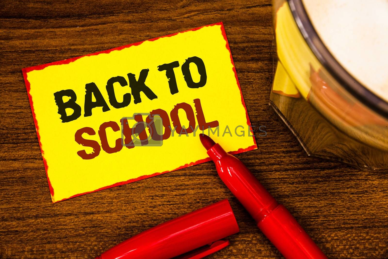 Writing note showing  Back To School. Business photo showcasing Return to class first day of studies Classroom Arriving Words yellow paper note red border open marker cap coffee glass desk