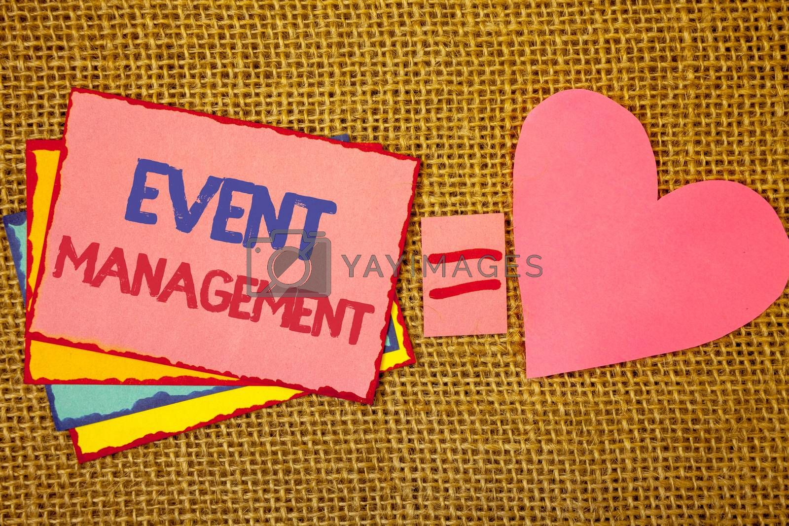 Writing note showing  Event Management. Business photo showcasing Special Occasion Schedule Organization Arrange Activities Pink yellow blue notes black red letters ideas equal sign heart wicker