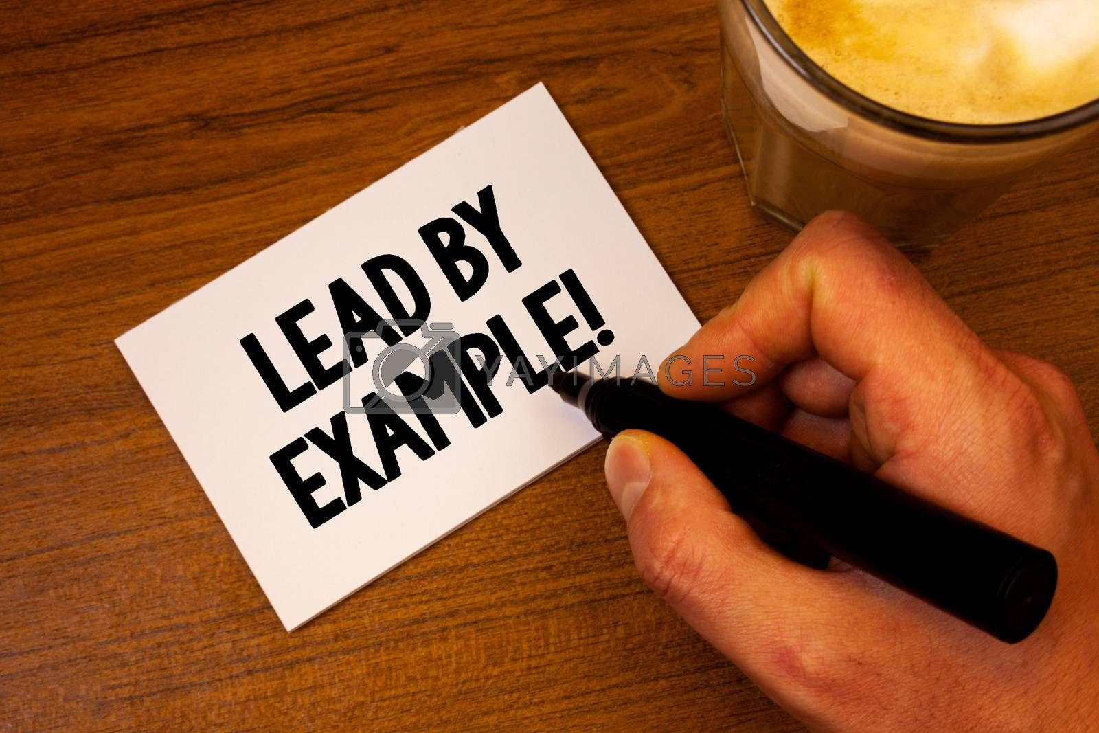 Conceptual hand writing showing Lead By Example Motivational Call. Business photo text Leadership Management Mentor Organization Text white paper hand black marker coffee glass letter