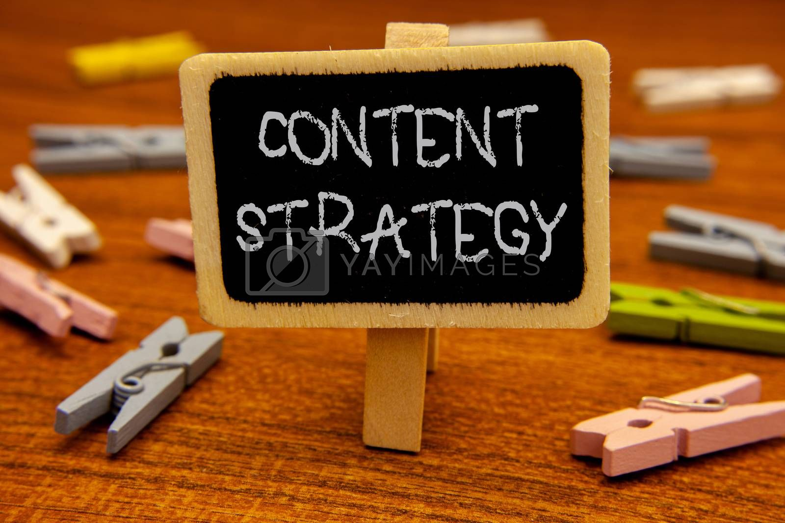 Conceptual hand writing showing Content Strategy. Business photo showcasing Management Network Internet Website Marketing Plan Blackboard chalk letters clothespin with wooden background