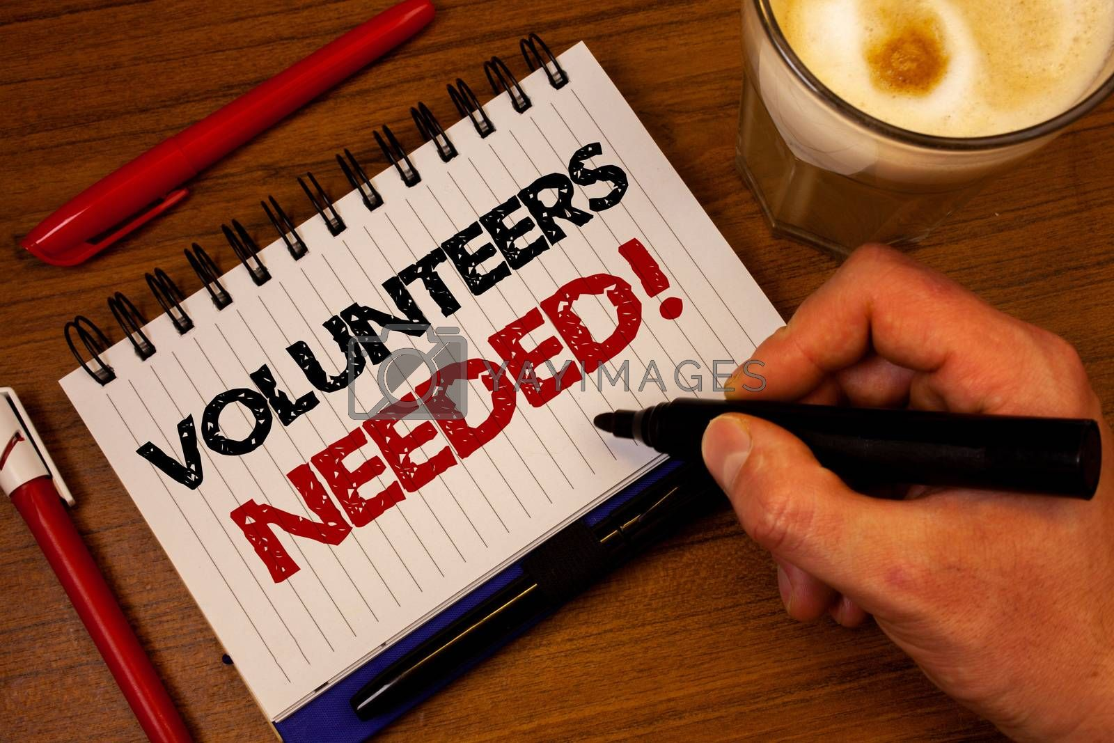 Word writing text Volunteers Needed Motivational Call. Business concept for Social Community Charity Volunteerism Hand grasp black marker wooden desk red pen notepad expos texts coffee