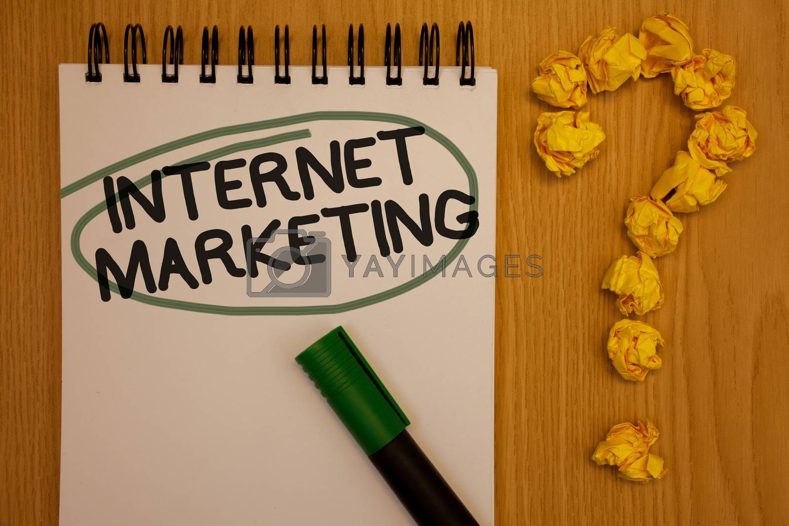 Writing note showing  Internet Marketing. Business photo showcasing Online Commerce Networking Entrepreneur Entrepreneurship Notepad rotund black words green pen woody desk balls form query mark