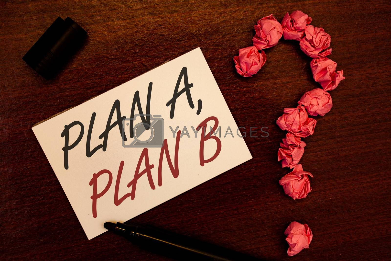Text sign showing Plan A, Plan B. Conceptual photo Strategic Solutions Ideas Paths to follow to choose from Text white paper note black marker open cap pink crumbled paper question