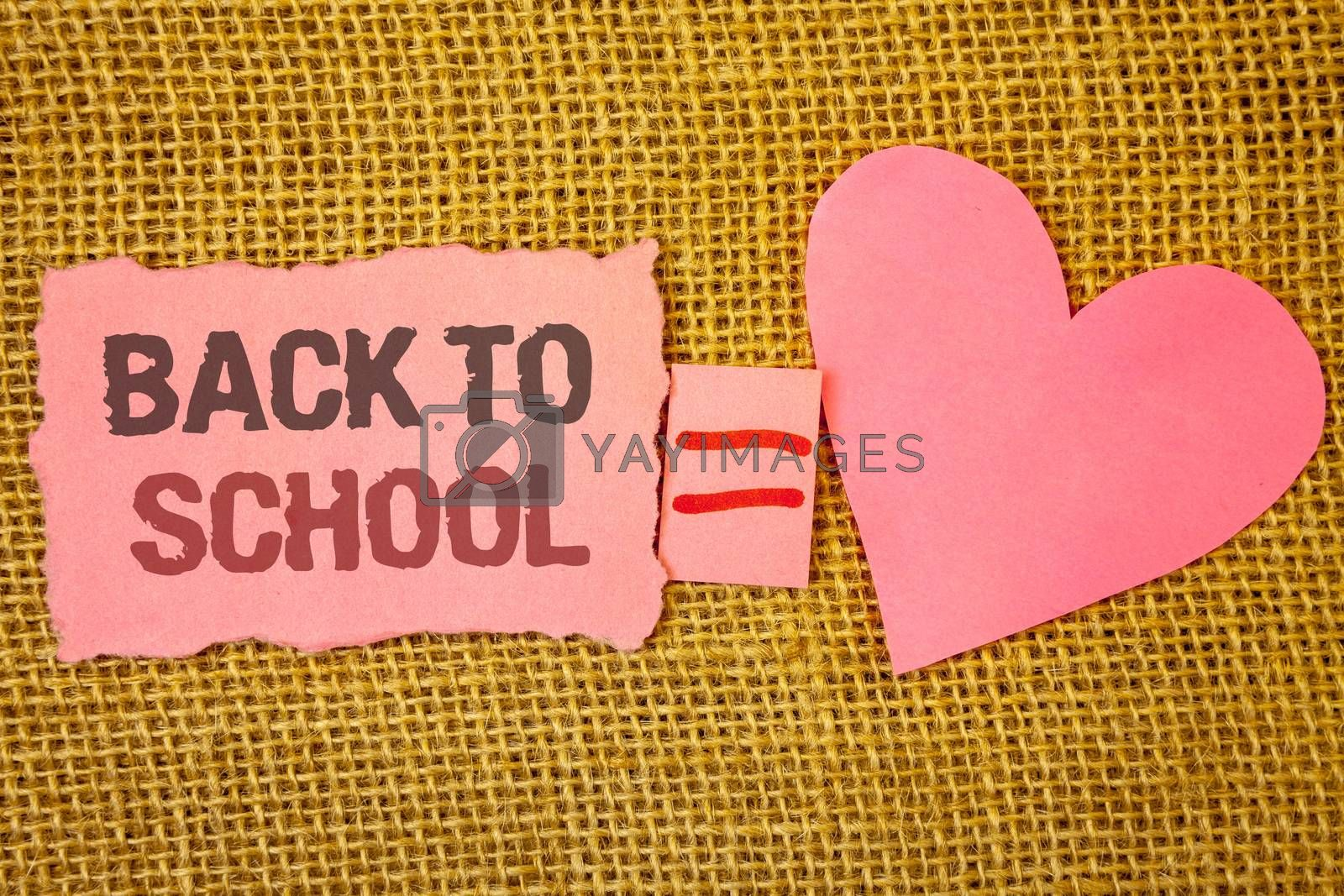 Text sign showing Back To School. Conceptual photo Return to class first day of studies Classroom Arriving Text pink torn note equals is pink heart love message letter cute couple